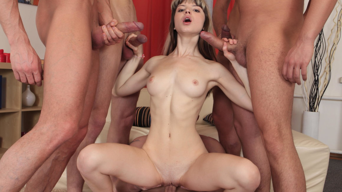 Petite babe copes with five big dicks at once